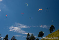 Paraglider-filled sky
